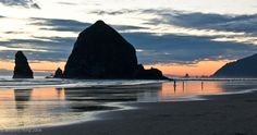 Haystack Rock, Oregon.  Although when we were there it was quite windy ... makes a much better picture in this calm weather!