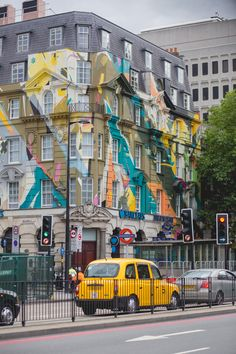 Painted building across from St. Pancras Station ~ London, England