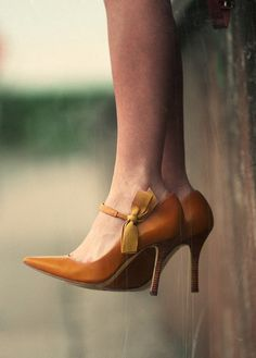 Vintage shoes with silk bow ties. I might actually wear heels if I had these. :)