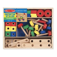 Melissa Doug Construction Set With 48 wooden pieces (including nuts, bolts, drilled bars to connect, and a child-size screwdriver), this classic building set gives kids all they need to tinker and build! Printed right on the sturdy storage box are building plans for a crane, motorcycle, airplane, and race car to get the fun