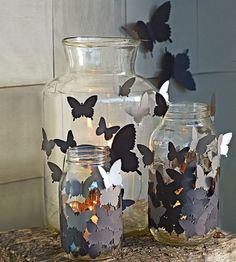 Use a butterfly-shaped punch to cut black and white paper. Then double-stick-tape your swarm of moths to glass jars.
