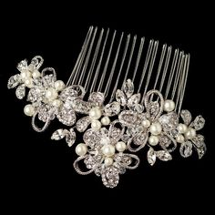 """""""Rhodium Diamond White Pearl, Swarovski Crystal Bead & Rhinestone Floral Ribbon Hair Comb"""" Bring a touch of elegance vintage to your wedding day ensemble with this irresistible bridal hair comb. The details of this comb features luxurious diamond white pearls accompanied by dazzling rhinestones and swarovski crystal beads. This captivating rhodium plated hair comb will bring an extra touch of romance to your bridal hairstyle.  Size: 5 1/4"""" x 2 1/4"""""""