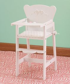 This high chair is the perfect way to pamper a constant companion. The pink and white rattle bar and lifting tray will complement any playroom as Dolly enjoys mashed peas and creamed corn in a whimsical wooden seat made just for them.