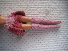 voici le petit deux en un short jupette que j'ai créé pour aller avec les chaussettes hautes matériel laine: idéal de bergère de france; une laine magnifique à tricoter ronde et régulière, un vrai plaisir, envoyé par mamieblue 59 aiguilles 3 points; mousse...