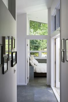 A new master bedroom suite was added to the rear of the home and designed around a new exterior courtyard area that connects to the larger living room patio.