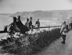 English children and an American guard from Army Service Forces watch from a cliffside fence as US troops in the distance practice landings along Slapton Sands (Beach) in preparation for the D-Day invasion of Normandy. Blackpool, Life Magazine, Slapton Sands, D Day Normandy, Normandy Beach, Normandy Invasion, D Day Landings, Landing Craft, Military History