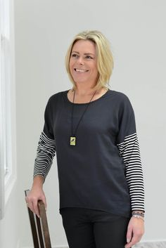 A stylish Curved Hem Top in a Charcoal Viscoes with a knit sleeve.