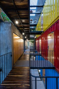 Stacked shipping containers house bedrooms at Vietnam hostel by TAK Architects #ContainerHomeDesigns