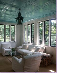 Sun room with French blue ceiling tiles, Louisiana cypress wall panels (Baton Rouge remodeled home, via Cote de Texas)