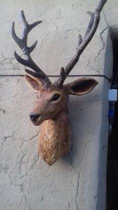 carved in wood deer head