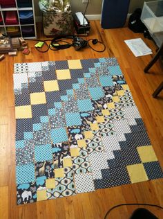 """Baby Elephant Walk quilt, a mixture of 5"""" squares and four patches, large and small scale prints"""
