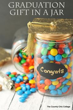 Graduation Gift in a Jar -- a fun gift for any graduate.  Be sure to hide money inside of a smaller jar in the candy!