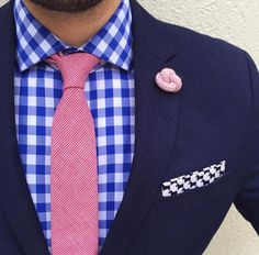 Blue Blazer, Blue checker shirt. Pink tie and Lapel pin.