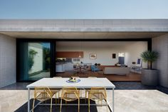 A typical Australian home uses the full width of the block and puts a garden in front and out the back; this home is far from typical.