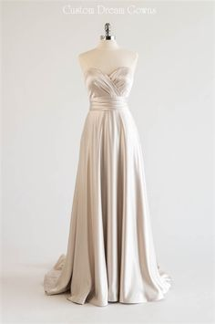 Beautiful #CustomWeddingDress! 8801 is a Charmeuse Satin A-Line Gown with a Strapless Sweetheart Neckline, Pleated Criss-Cross Fitted Bodice with a Pleated Cumberbund at Natural Waist, Lightly Padded Bust Cupst & Interior Boning, A-Line Skirt into Chapel Train, Low V-Back with Covered Buttons Over Zipper. #strapless #justin8801 #satinweddingdresses #alineweddingdresses #bridalgowns #2016weddingdresses #classic #beautiful #elegant #weddingdresses #customweddingdress #customdreamgowns…