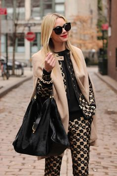 The Gucci bag is nice but I love the patterned pantsuit!