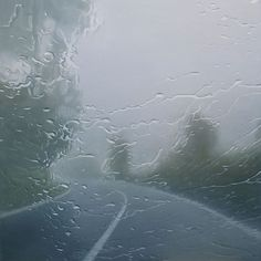 Paintings of rain-soaked street scenes as seen from behind the windshield of a car by Dutch artist Esther Nienhuis.