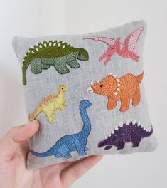 Little dinosaur cushion for a new born baby boy! Cushion Embroidery, Baby Embroidery, Embroidered Cushions, Embroidery Patches, Hand Embroidery Patterns, Cross Stitch Embroidery, Simple Cross Stitch, Needlework, Sewing Projects