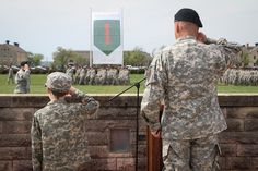 """Command Sgt. Maj. Ian Field (left) and Lt. Col. James Lander (right), the incoming commander of the 1st Battalion, 28th Infantry Regiment, 4th Infantry Brigade Combat Team, 1st Infantry Division, salute during a pass in review at the battalion's change of command ceremony May 8 at Cavalry Parade Field at Fort Riley, Kan. The 9-year-old visited the battalion two years ago through Make-A-Wish America, spending several days with the """"Black Lions"""" to achieve his dream of being a Soldier."""