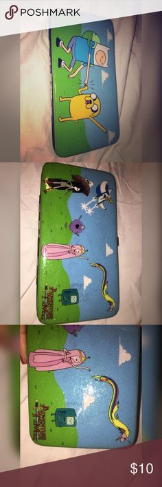 Hot Topic Adventure Time wallet Cartoon Network's Adventure Time wallet. Good condition, some minor wear on outside. Hot Topic Accessories