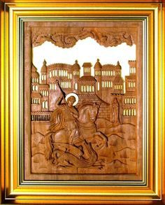 This is a carved orthodox icon representing Saint George. It is carved into a single piece of pear-tree wood, which is a special kind of wood, hard to work with, but with great results.