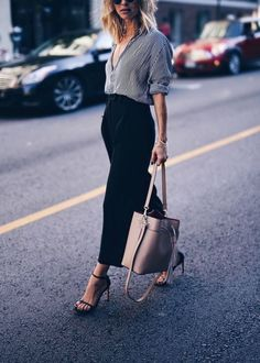 Street style | Pin striped shirt, black pants, heels and a blush handbag