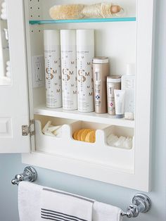 """If you've ever fidgeted with packaging for beauty care products, you'll love the convenience of """"decanting"""" cosmetic sponges and cotton rounds and stowing them in small bins or containers tucked inside the medicine cabinet. Open the door and voila -- it's a breeze to grab what you need."""