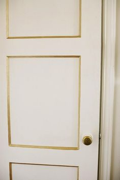 SallyL: Rue Magazine - Traditional, paneled doors with brass hardware and gold edged panels.