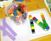 Alphabet center- ABC mats and linking cubes / might even make upper case and lower case letters with a sharpie on the blocks to sort onto two different mats. Kindergarten Centers, Kindergarten Literacy, Preschool Classroom, Literacy Centers, Abc Centers, Literacy Stations, Reading Centers, Teaching Letters, Preschool Letters