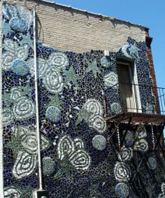 Mosaic on the back of a building in Minneapolis. Just found it on a random walk but it was awesome.
