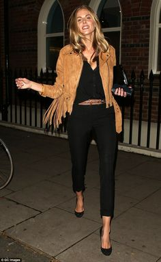 Plenty to smile about: Donna Air looked happier than ever as she stepped out in London on ...