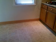 Ceramic Tile: Final Step Grout, Sealant and Oak Baseboard. Installed by LTJ Construction Services