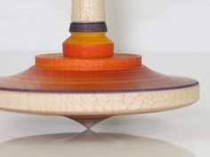 Wooden SPINNING TOP with Red Stripes