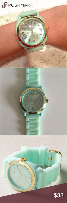 Anthropologie Viscid Watch A bright gummy strap is lent sophistication from serious gold hardware.  Rubber, metal, glass Anthropologie Accessories Watches