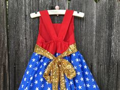 *Custom Boutique Wonder Woman/ Girls BIrthday Costume. *Available in sizes 9m 12 18 24 2t 3t 4t 5t 6 7 8 girl. --------------------------------------------------------------------------------------------------------------- *Welcome to Lil Bug Clothing a place where you can find fun funky unique clothing for every little girl. Each item is custom handmade upon purchase. *TURN AROUND TIME Please visit my store front page for current turn around time. (Click link below to view store fron...