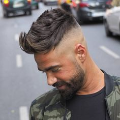 High fade haircuts cut hair ultra short or down to the skin around the sides and back of the head. This gives the appearance of thicker hair and focuses attention to the style on top, whether