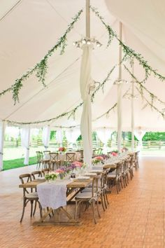 Pairing rustic tables and the prettiest peonies is already a winning combination, but add all-natural green garlands to your wedding tent + you've got a dreamy farm venue.