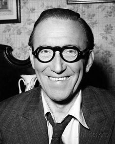 """was a prominent English comedian and actor. Askey's humour owed much to the playfulness of the characters he portrayed, his improvisation, and his use of catchphrases, which included """"Hello playmates!"""", """"I thank you"""" (pronounced """"Ay-Thang-Yaw""""), and """"Before your very eyes"""".  ARTHUR. ASKEY Comedy Actors, Actors & Actresses, Arthur Askey, English Comedians, I Thank You, Entertaining, Black And White, Eyes, Film"""