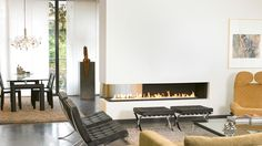 This contemporary three sided fireplace can actually be enjoyed from three sides of a room. The modern dancing flames twinkles away creating a wonderful ambiance and with its sleek lines, a three sided linefire is an ideal way to break up a space and create a seamless division whilst simultaneously creating a wonderful contemporary feature.