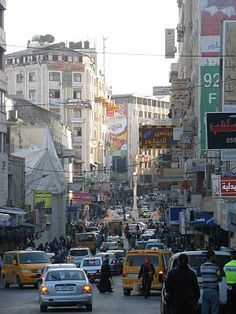 Ramallah, Palestine. Yep. Wasn't this hot on our trip, but the street looks the same. Busy.