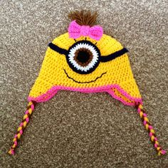 Girl minion style hat ~ crochet without the brown in the eye. One purple one pink