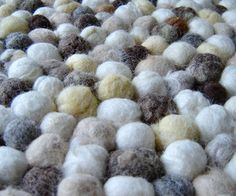 Could do with all my roving, odd pieces of wool, and Wawllay fur.  -- From artist: I first saw this type of rug in a design magazine, it was called Hay Pinocchio Rug. It was gorgeous the felt balls were made from brightly coloured wo...