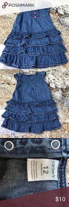 Jean Dress by Carter's size 12 months Super cute Jean dress with pink buttons in the front and snaps in the back. In great condition. Carter's Dresses