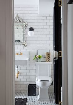 Pretty white brick tiled bathroom: http://www.stylemepretty.com/living/2016/11/02/giving-an-outdated-bathroom-a-stunning-and-timeless-makeover/ Photography: Ashley Capp - http://www.ashleycapp.com/