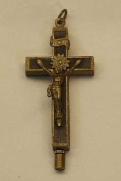An antique crucifix reliquary. It contains relics from 5 labeled saints. Condition: Age-appropriate wear and patina. See all photos.