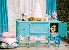 Turquoise and pink backdrop and pillows