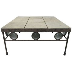 Wrought Iron and Stone Top Coffee Table   From a unique collection of antique and modern coffee and cocktail tables at http://www.1stdibs.com/furniture/tables/coffee-tables-cocktail-tables/