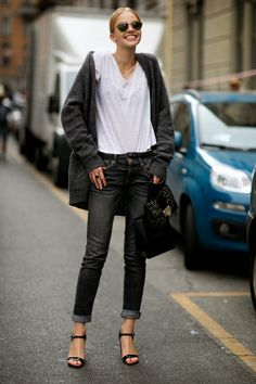 Black jeans, white t, black strappy heels and a chunky sweater.