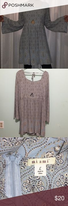 NWOT Country Classic Dress BRAND NEW, never worn, without tags, size Large dress! Fitted at the waist with a trendy cut-out! Flowy skirt for a super comfy and cool fit. Wide boho sleeves! Has a little hole to show some skin under the bust 😉 Blue, gray, and cream/tan detailing. Pair it with a choker and nude wedges for a chic look! Or a pair of cowboy boots! Fits true to size. Francesca's Collections Dresses Mini