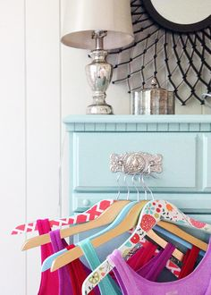 Use Mod Podge and printed paper to DIY these colorful hangers.